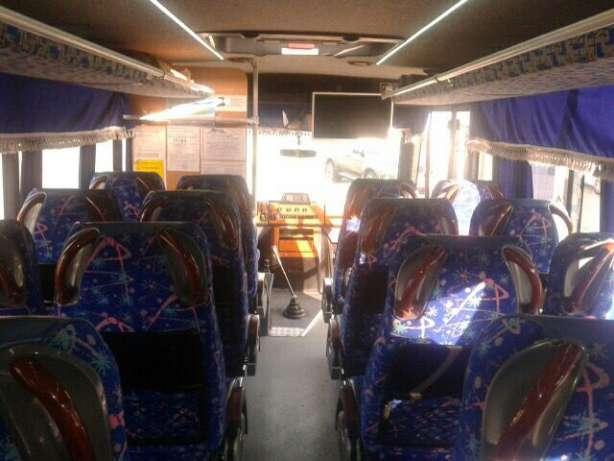 нанять автобус